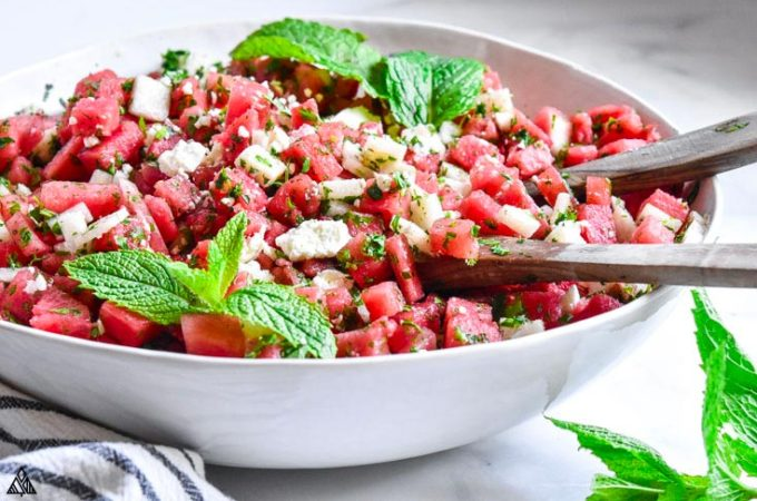 Side view of watermelon salad in a bowl