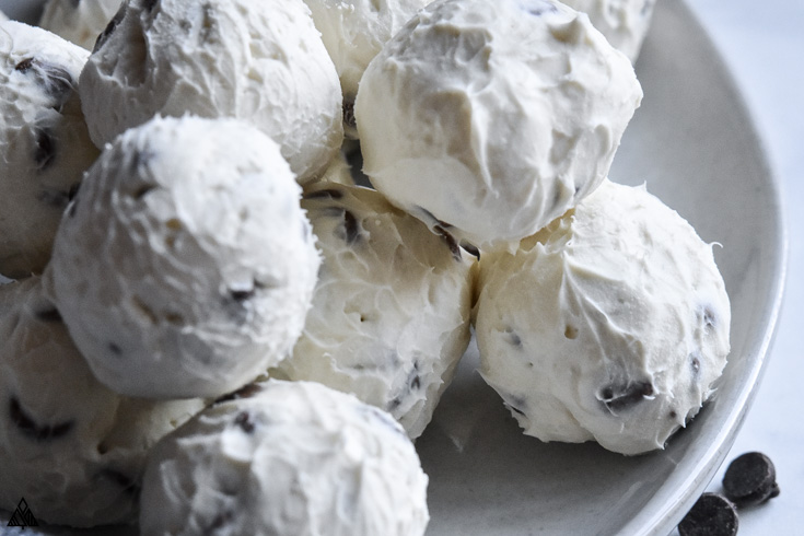 Top view of cream cheese fat bombs in a plate