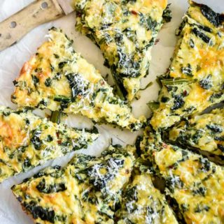 Top view of sliced crustless spinach quiche