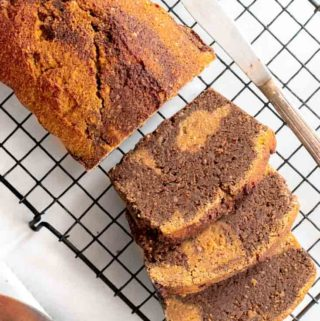 Top view of a loaf and slices healthy pumpkin bread
