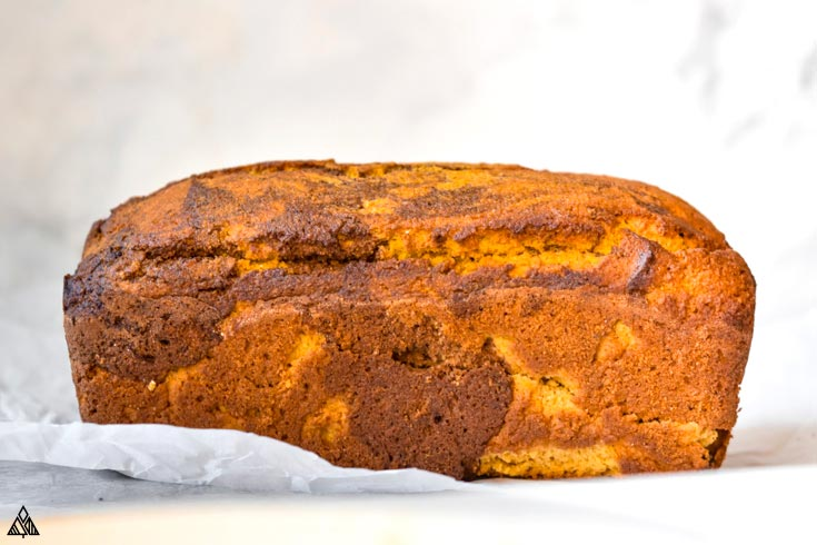 A loaf of healthy pumpkin bread in a parchment paper