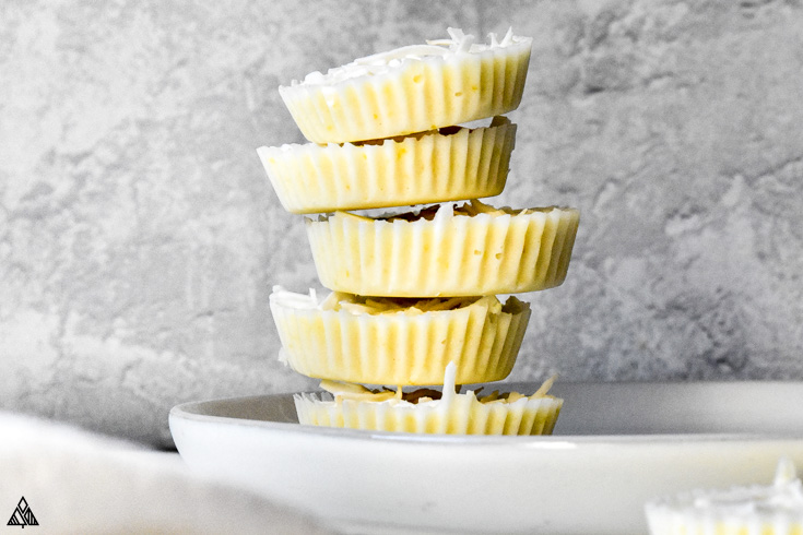 Stack of lemon fat bombs in a plate