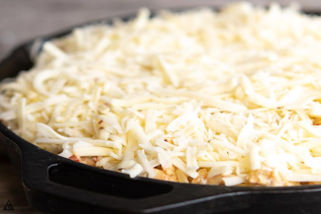 Shredded cheese on top of the low carb mexican casserole