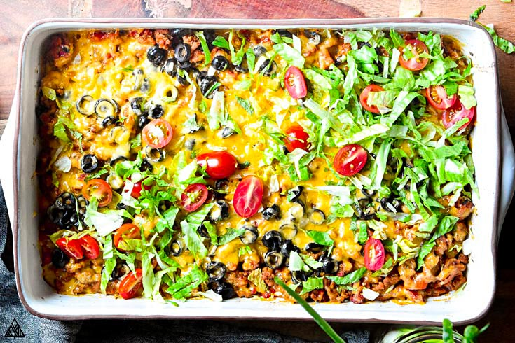 Top view of low carb taco casserole with toppings