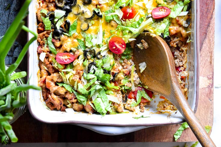 Low carb taco casserole with a ladle