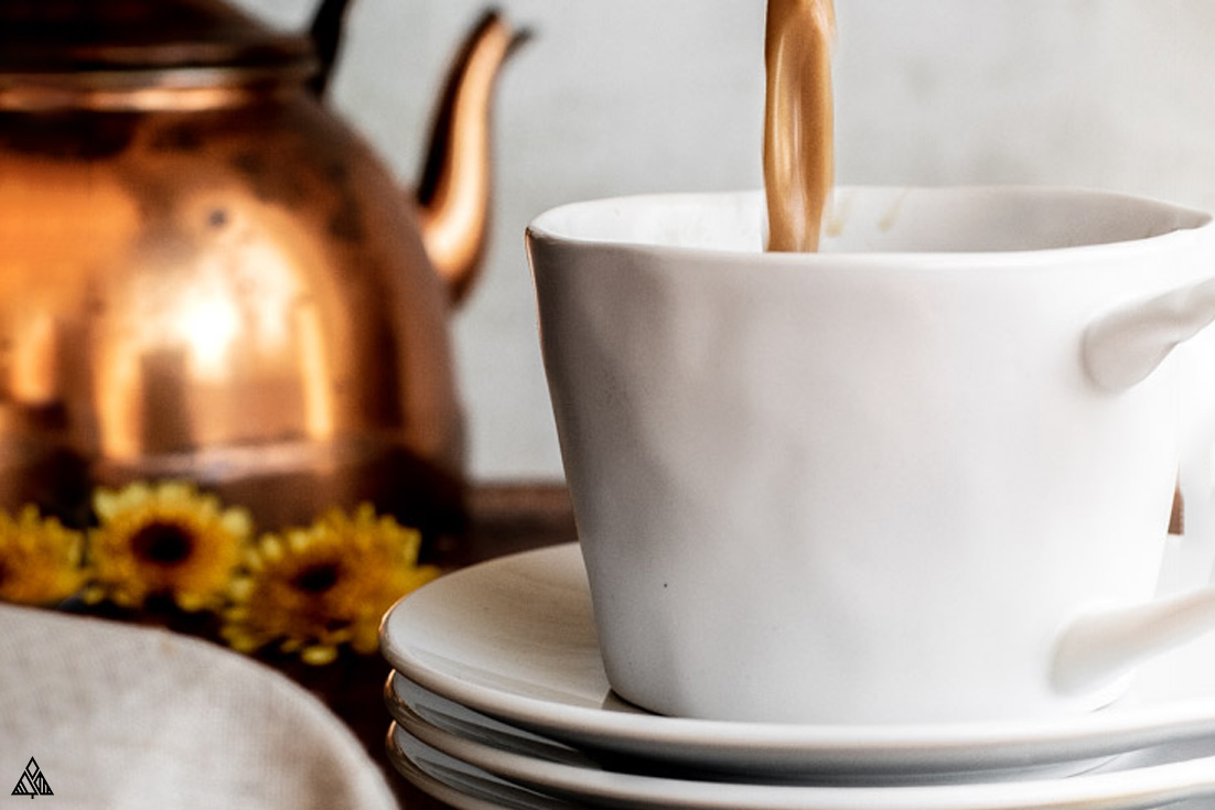 Pouring sugar free pumpkin spice latte into a mug