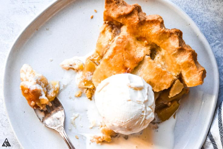 Closer look of low carb apple pie topped with a scoop of ice cream