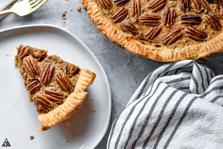 A slice of low carb pecan pie in a plate